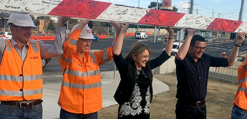 Level crossing boom gate removal, with David Andrews and Jacinta Allan. Photo: Level Crossing Removal Authority