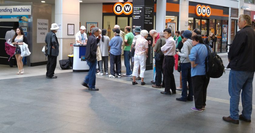 Seniors line up at Chatswood railway station for their Opal cards. Photo: Oliver Probert